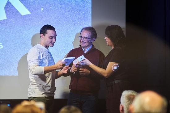 Winner receiving award at Urbanpeek competition 2016