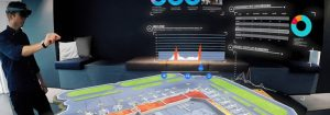hombre con gafas de realidad aumentada gestionando un escenario virtual de un aeropuerto