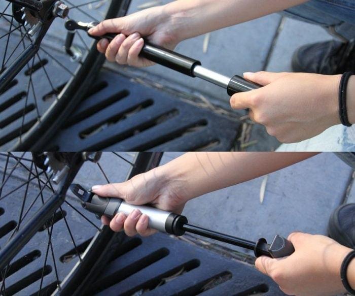 Imagen que muestra una persona hinchando una rueda de bici con una bomba