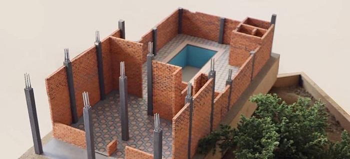Una casa en miniatura realizada con materiales y técnicas constructivas reales
